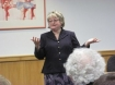 Author Pamela Aiden speaks at a reception in her honor at the Wilsonville Public Library.