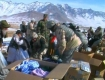 Aid being distributed to Afghan people in a remote mountain village in 2007