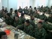 Afghan National Army soldiers take a break and eat a meal in Kabul.