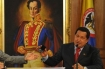 Hugo Chávez Under a Painting of Simón Bolivar