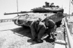 IDF soldiers struggle to repair a tank damaged by Hesbollah during the fighting in 2006. Photo by Dexter Phoenix