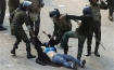 Egyptian security forces beating up woman; these men are who the Morsi supporters allegedly battled