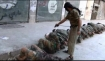 Obama-backed FSA terrorists executing Syrian soldiers