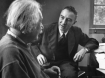 Physicist J. Robert Oppenheimer discusses theory of matter with famed Physicist Dr. Albert Einstein.