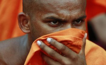 A Buddhist monk protesting in Colombo, 2010. (Andrew Caballero-Reynolds / Courtesy Reuters)