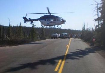Helicopter landing on Highway 242