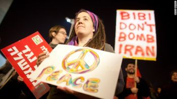 Protestors sign in Israel reads, reads, 'Bibi Don't Bomb Iran'