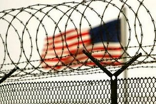 U/S/ flag and barbed wire