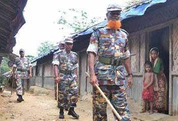 Border guards in Rohingya village in Burma
