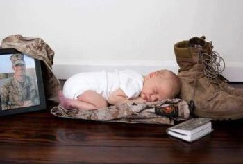 Baby sleeping on dad's uniform