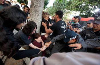 Israeli policemen beat and arrest women at a demonstration held by the feminist movement New Profile