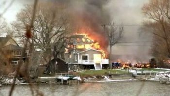 Firefighters were called to a house fire in Webster, N.Y. on Dec. 24, 2012, only to find a gunman. (ABC News)