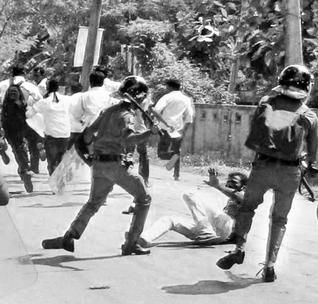 Police clash with university students in Jaffna on November 28.