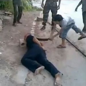 US-funded FSA child soldier beheads government victim.