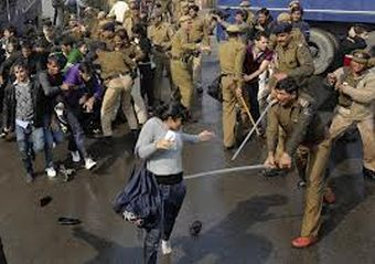 Police in India brutalize people gathered for a protest against a recent gang rape in Delhi.