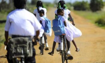 Sri Lankan children ride bicycles in Jaffna. (AFP)