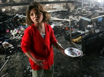 Girl from Gaza in her former classroom at a United Nations school bombed by Israel