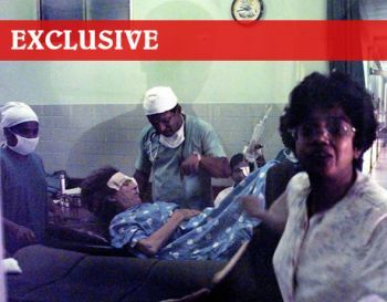 Medical staff examine Marie Colvin in the corridor outside the operating theatre in Colombo's eye hospital, in Sri Lanka Tuesday April 17, 2001