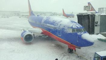 Snow and ice halt hundreds of flights at Chicago Midway Airport on Sunday, Jan. 5, 2014. (Twitter photo/Keith Chard).