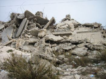 The remains of a 7-story Palestinian apartment building, one of over 22,000 Palestinian homes that Israel has demolished.