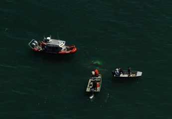 Coast Guard boats aid in search for downed helicopter