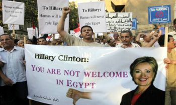 Sign reads: Hillary Clinton not welcome in Cairo