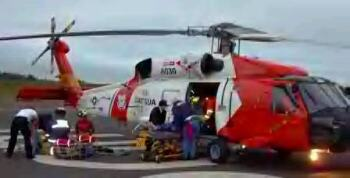 coast guard helicopter and rescued party
