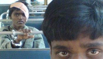 Handcuffed Tamil girl on bus