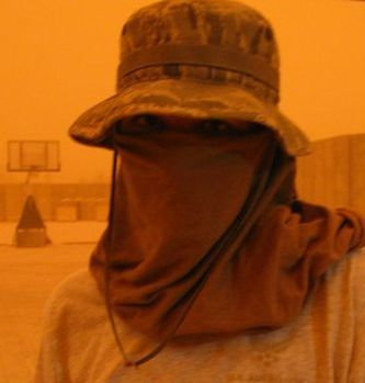 Woman serving in US military during a severe sandstorm at Balad, Iraq