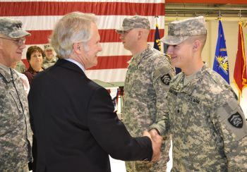 Oregon Governor John Kitzhaber congratulates Oregon Army National Guard Spc. Steven Armstrong