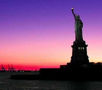 Stateue of Liberty at sunset