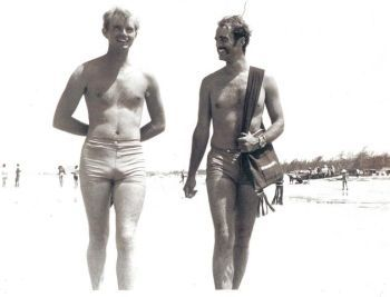 Perry Deane Young and Sean Flynn walking on the beach in Vietnam