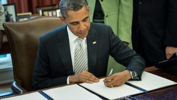 Obama signs the Monsanto protection act. Photo: rt.com
