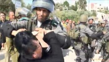 Israeli soldier abusing a civilian woman