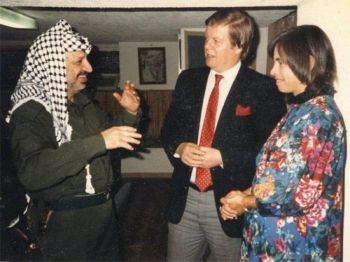 Alan and his wife Nicole in conversation with Chairman Arafat