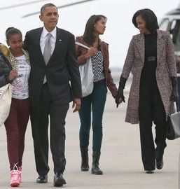 The picture of the Obama family, at top, is by Doug Mills of the New York Times.