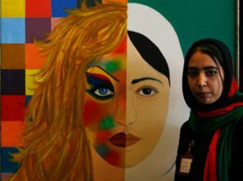 Khadija Hashemi, 21, an Afghan female artist, stands next to her painting during the first ever woman's art exhibition at Amani school in Kabul, Afghanistan in 2008.
