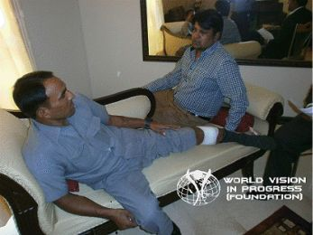 Farrukh A Saif is seen in Allied Hospital, Faisalabad with the Pastor