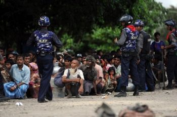 Rohingya people under guard by Myanmar officials