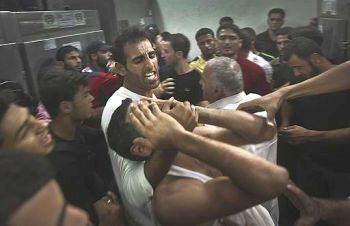 Gaza men in anguish after Israeli attack killed loved ones.