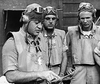 Major Greg 'Pappy' Boyington and members of the U.S. Marine Corps' VMF-214 Black Sheep Squadron.