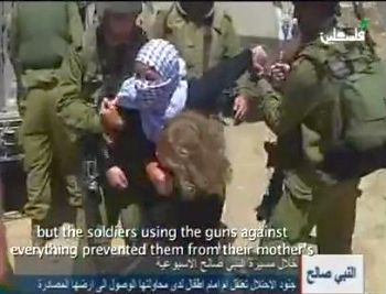 Photos from associated video clip, little girls being manhandled by Israeli male soldiers as their mom's arrested.