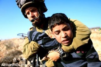14 year-old Mohammed Awad arrested by an Israeli soldier in Beit Ommar, 11/20/2010. Picture: Anne Paq/ActiveStills