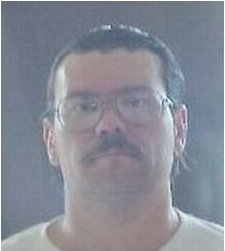 Tod Harvey is a white male, 5'10, 210 pounds, brown hair, brown eyes and a moustache. He wears glasses and has a scar on his right forearm.Photo: OSP